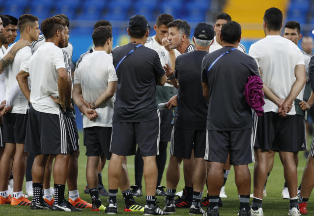 Mexico head coach Juan Carlos Osorio gives instructions to his players during Mexico's official training on the eve of the group F match between South Korea and Mexico at the 2018 soccer World Cup at the Rostov Arena, in Rostov-on-Don, Russia, Friday, June 22, 2018. (AP Photo/Eduardo Verdugo)