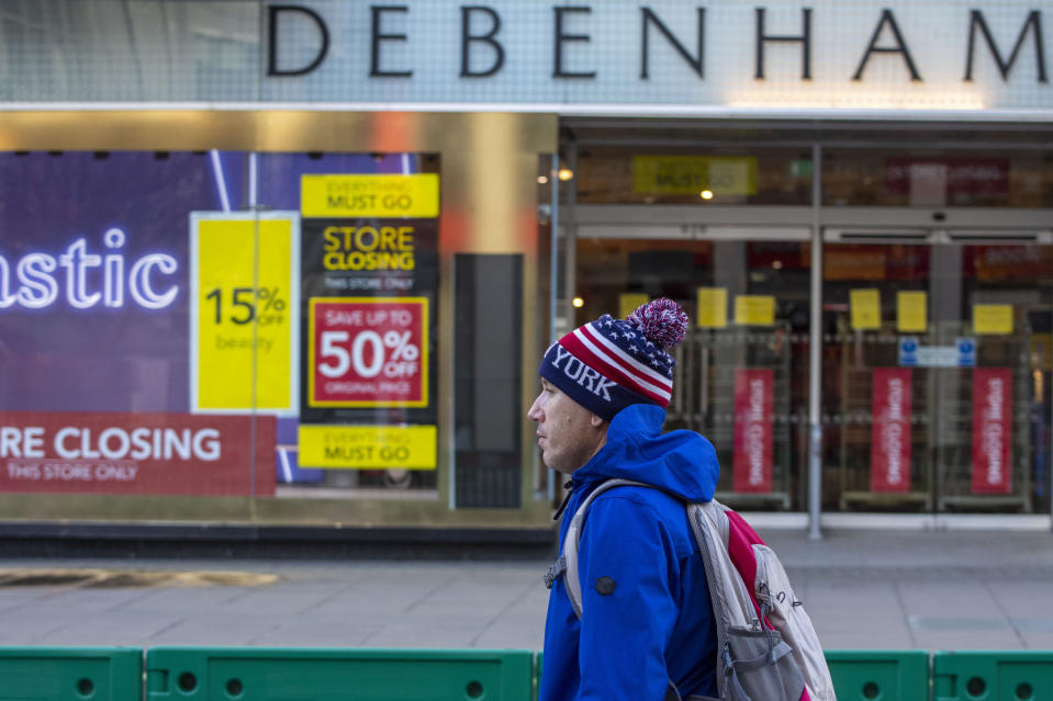 LONDON, UNITED KINGDOM - 2020/12/27: A man walks past a Closed Debenhams Store in Oxford Street. Under tier four restrictions, pubs and restaurants will close, as well as non-essential retail. (Photo by Pietro Recchia/SOPA Images/LightRocket via Getty Images)