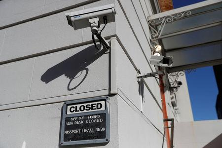 Surveillance cameras are seen above a closed sign outside the Consulate General of Russia in San Francisco, California, U.S., October 3, 2017. REUTERS/Stephen Lam