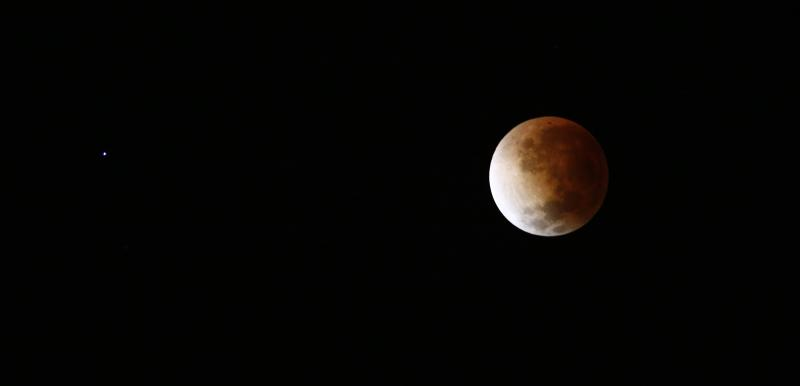 The moon is seen as it begins a total lunar eclipse over Buenos Aires