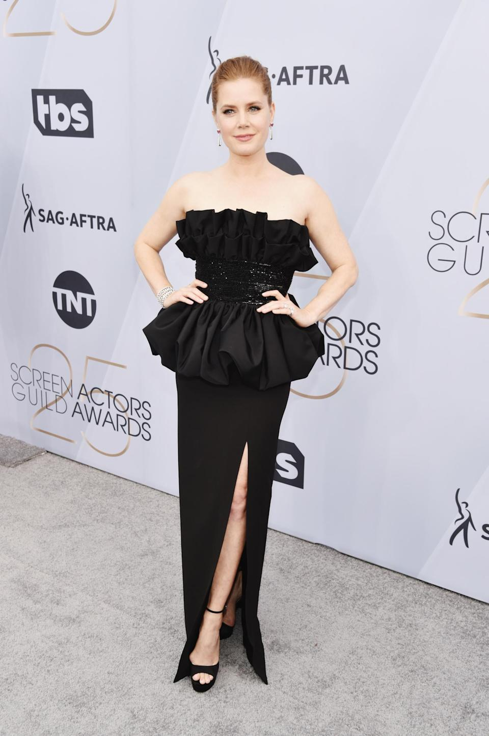 <p>A double nominee — for the film <em>Vice</em> and HBO's <em>Sharp Objects —</em> Amy Adams selected a black strapless Celine dress paired with Cartier jewelry for this year's SAGs. (Photo: Getty Images) </p>