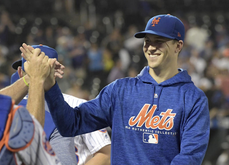 Mets ace Jacob deGrom tops Max Scherzer and Aaron Nola to win the National League Cy Young award. (AP)