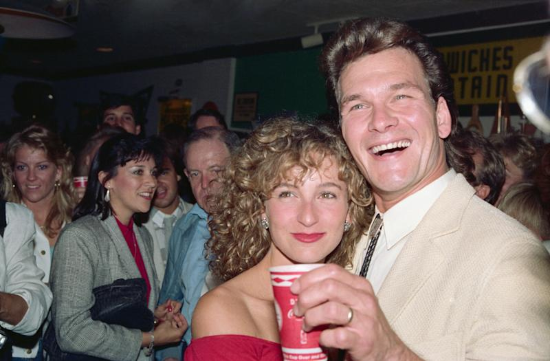"""Jennifer Grey (right) and Patrick Swayze at the premiere of """"Dirty Dancing"""" in 1987. (Photo: Bettmann via Getty Images)"""