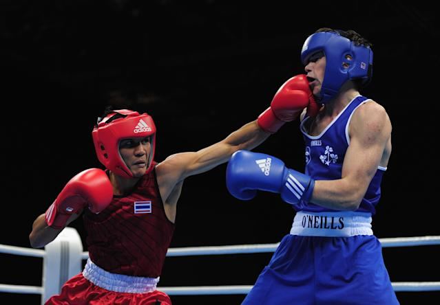 LONDON, ENGLAND - NOVEMBER 25: Declan Geraghty of Ireland (Blue) trades punches with Worapoj Petchkoom of Thailand during their quaterfinal, 56kg bout at ExCel on November 25, 2011 in London, England. (Photo by Jamie McDonald/Getty Images)