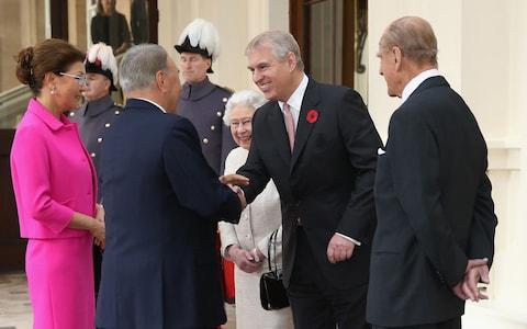 Nursultan Nazarbayev and his daughter Dariga meet the Queen, Prince Andrew and Prince Philip at Buckingham Palace in 2015 - Credit: Chris Jackson/Getty