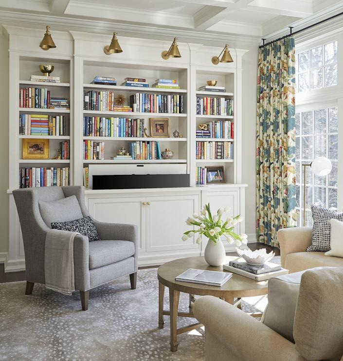 "<p>In this era of Zoom meetings, our bookshelves speak volumes. Talking to OprahMag.com, author <a href=""https://www.oprahmag.com/entertainment/books/a35490131/lily-king-short-story-timeline/"" rel=""nofollow noopener"" target=""_blank"" data-ylk=""slk:Lily King"" class=""link rapid-noclick-resp"">Lily King</a> confessed that she was wary of audiences scanning her shelves during her <a href=""https://www.oprahmag.com/entertainment/a33902384/authors-virtual-book-tour-experience/"" rel=""nofollow noopener"" target=""_blank"" data-ylk=""slk:virtual book tour"" class=""link rapid-noclick-resp"">virtual book tour</a>. ""It just makes me really uneasy. It's like, ""No, no, don't judge me,"" she said.</p><p>As King points out, so often, our bookshelves are forms of self-expression. ""They speak to your personality,"" <a href=""https://www.nikkiklughdesign.com/"" rel=""nofollow noopener"" target=""_blank"" data-ylk=""slk:Nikki Klugh, an interior designer"" class=""link rapid-noclick-resp"">Nikki Klugh, an interior designer</a> based in San Diego, CA, says. ""They can express your style, what's important to you, and what you value.""</p><p>There are countless approaches to organizing bookshelves. While Klugh <a href=""https://www.oprahmag.com/entertainment/a33967855/color-coded-rainbow-bookshelves-debate/"" rel=""nofollow noopener"" target=""_blank"" data-ylk=""slk:recommends grouping books by color"" class=""link rapid-noclick-resp"">recommends grouping books by color</a> for aesthetic purposes, those with a lot of tomes may want to stack them by genre or alphabetically so you can access them more efficiently. For a more streamlined look, arrange books by height, with the tallest on both sides of the shelves. </p><p>Below, find tips sourced from interior designers and professional organizers that'll help you make your library, <a href=""https://www.oprahmag.com/life/g34498884/reading-nook-ideas/"" rel=""nofollow noopener"" target=""_blank"" data-ylk=""slk:reading nook"" class=""link rapid-noclick-resp"">reading nook</a>, or <a href=""https://www.oprahmag.com/life/g26379318/diy-bookshelf-ideas/"" rel=""nofollow noopener"" target=""_blank"" data-ylk=""slk:DIY bookshelf"" class=""link rapid-noclick-resp"">DIY bookshelf</a> both beautiful and functional. <br></p>"