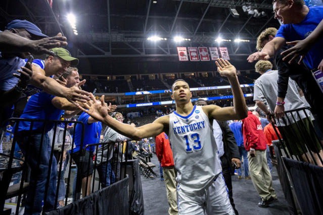 Kentucky's Jemarl Baker Jr. (13) is greeted by fans as he leaves the court after defeating Wofford in a second-round game in the NCAA mens college basketball tournament in Jacksonville, Fla., Saturday, March 23, 2019. (AP Photo/Stephen B. Morton)