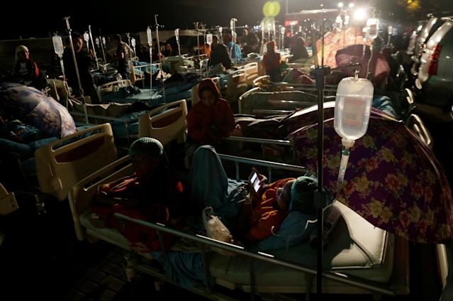 <p>Patients are seen outside a hospital following a strong earthquake on nearby Lombok island, at a government hospital near Denpasar, Bali, Indonesia, Aug. 5, 2018. (Photo: Johannes P. Christo/Reuters) </p>
