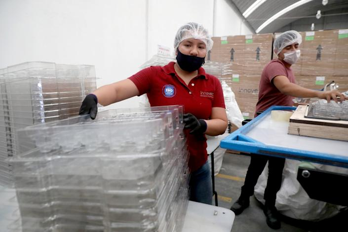 """A factory worker at Innovet, a company that shifted to making plastic visors and other protective gear when the coronavirus threatened to put it out of business. <span class=""""copyright"""">(Gary Coronado / Los Angeles Times)</span>"""