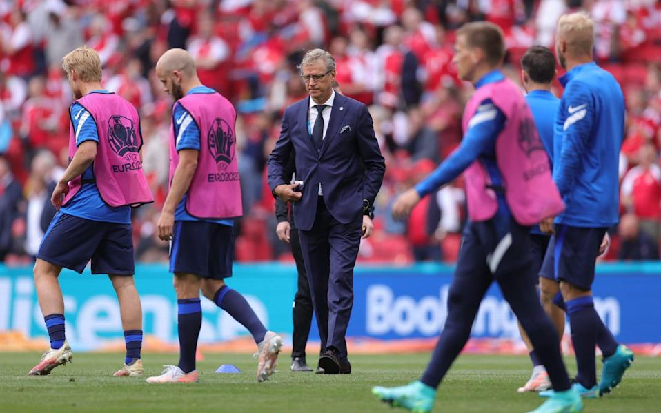 Finland coach Markku Kanerva and players during the warm up before the match - Reuters