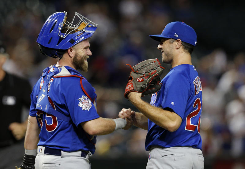 Chicago Cubs catcher Taylor Davis and pitcher Brandon Kintzler (20) celebrate after the Cubs defeated the Arizona Diamondbacks 9-1 during a baseball game Tuesday, Sept. 18, 2018, in Phoenix. (AP Photo/Rick Scuteri)