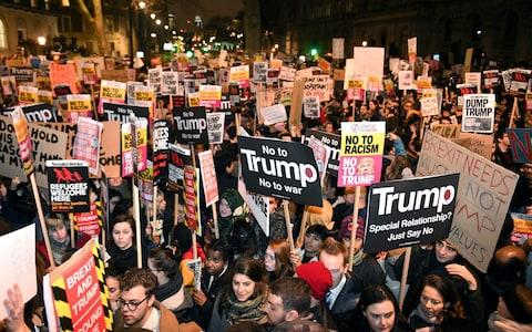 demonstrate during a protest at Downing Street in central London against US President Donald Trump's controversial travel ban on refugees - Credit: Victoria Jones/PA