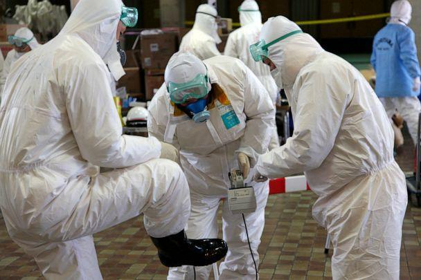 PHOTO: Radiation scanning crews check eath other's levels as they change their working shift at a screening centre in Koriyama in Fukushima prefecture, west of TEPCO's striken Fukushima No.1 nuclear power plant, March 18, 2011. (Go Takayama/AFP via Getty Images)