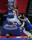 Detroit Pistons guard Saben Lee (38) loses control of the ball as Denver Nuggets guard Markus Howard (00) defends during the first half of an NBA basketball game, Friday, May 14, 2021, in Detroit. (AP Photo/Carlos Osorio)