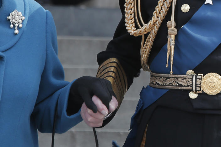 FILE - In this March 13, 2015 file photo, Britain's Queen Elizabeth, accompanied by Prince Philip, leaves after attending a service of commemoration to pay tribute to members of the British armed forces past and present who served on operations in Afghanistan, at St Paul's Cathedral, in central London. Buckingham Palace officials say Prince Philip, the husband of Queen Elizabeth II, has died, it was announced on Friday, April 9, 2021. He was 99. Philip spent a month in hospital earlier this year before being released on March 16 to return to Windsor Castle. Philip, also known as the Duke of Edinburgh, married Elizabeth in 1947 and was the longest-serving consort in British history. (AP Photo/Lefteris Pitarakis, File)