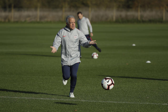 FILE - United States national soccer team interim head coach Dave Sarachan runs with a ball during a training session in west London, in this Monday, Nov. 12, 2018, file photo. Former U.S. interim coach Dave Sarachan has been hired as coach of Puerto Rico's soccer team. The 66-year-old Sarachan will lead Puerto Rico in qualifying for the 2022 World Cup, the Puerto Rican Football Federation said Wednesday, Feb. 24, 2021. (AP Photo/Matt Dunham, File)
