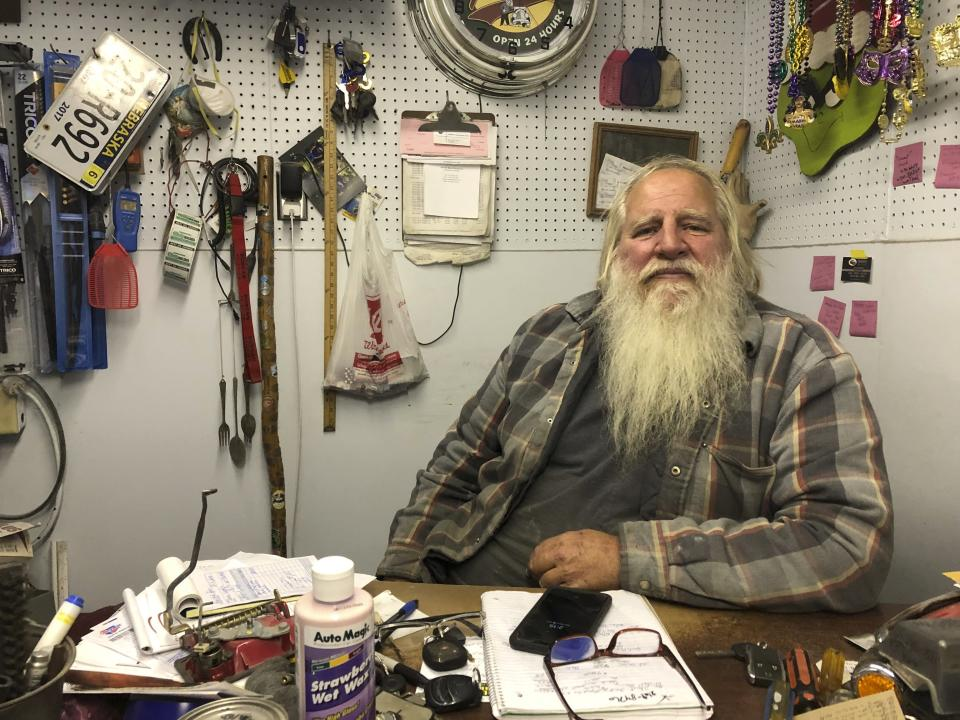 Danny Rice, 67, discusses the coronavirus in his auto repair shop in downtown Elmwood, Nebraska, on Monday, Nov. 9, 2020. Rice has continued his life as normal during the pandemic, even though he recognizes that the virus is potentially dangerous for high-risk people, including him. (AP Photo/Grant Schulte)
