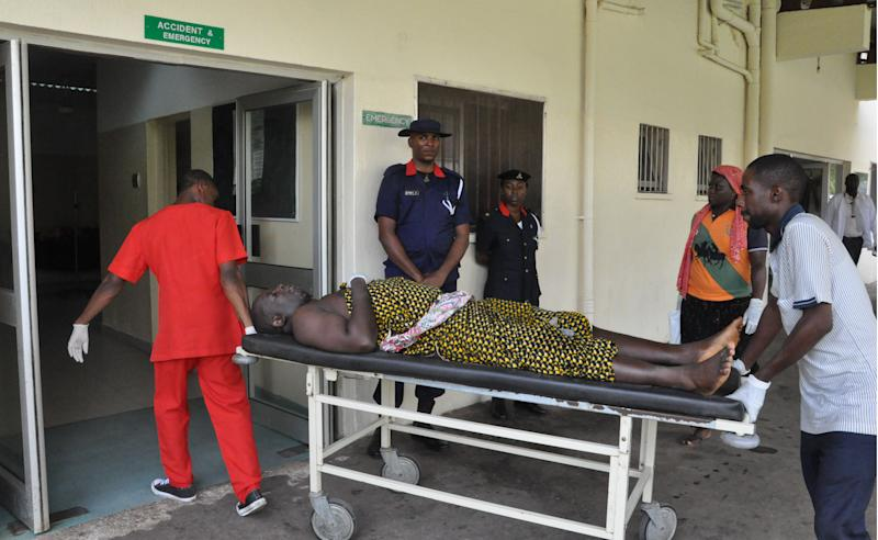 A victim of a car bomb explosion is wheeled into the Emergency and accident unit of Asokoro hospital in Abuja, Nigeria, Friday, May 2, 2014. The death toll from a car bomb that exploded on a busy road in Nigeria's capital rose to more than a dozen overnight with dozens of people wounded, police said Friday from the city that within days hosts an international conference. The bomb was driven near a checkpoint where traffic built up, right across the road from a busy bus station where a massive explosion on April 14 killed dozens of people. (AP Photo / Gbemiga Olamikan)