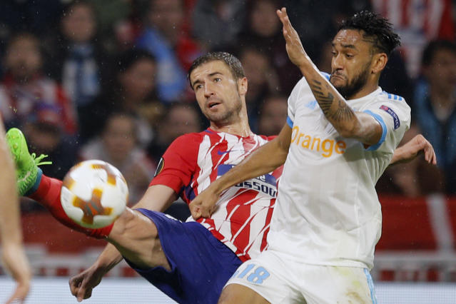 Atletico's Gabi, left, and Marseille's Jordan Amavi vie for the ball during the Europa League Final soccer match between Marseille and Atletico Madrid at the Stade de Lyon in Decines, outside Lyon, France, Wednesday, May 16, 2018. (AP Photo/Francois Mori)