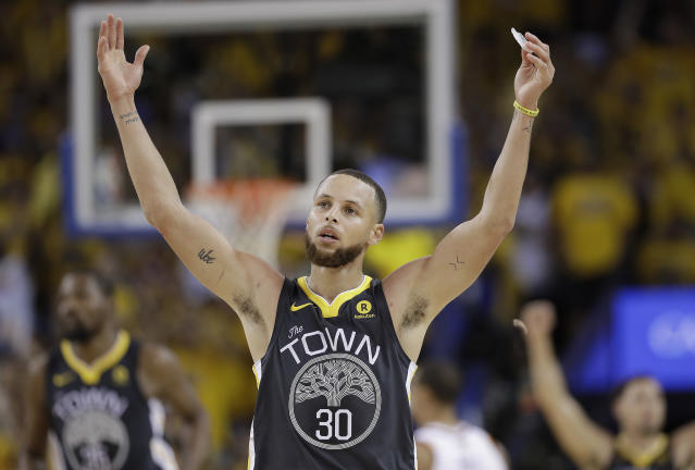 Steph Curry celebrates a 3-pointer in the second half of Game 2 Sunday night. (Getty)