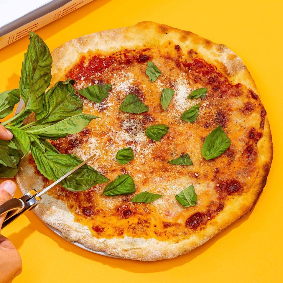 """<p>Instead of waiting for hours, you can get this <a href=""""https://www.popsugar.com/buy/Di-Fara-Classic-Neapolitan-Pizza-574367?p_name=Di%20Fara%20Classic%20Neapolitan%20Pizza&retailer=goldbelly.com&pid=574367&price=89&evar1=yum%3Aus&evar9=47494422&evar98=https%3A%2F%2Fwww.popsugar.com%2Ffood%2Fphoto-gallery%2F47494422%2Fimage%2F47494423%2FDi-Fara-Classic-Neapolitan-Pizza&list1=shopping%2Cpizza%2Cgoldbelly&prop13=api&pdata=1"""" rel=""""nofollow"""" data-shoppable-link=""""1"""" target=""""_blank"""" class=""""ga-track"""" data-ga-category=""""Related"""" data-ga-label=""""https://www.goldbelly.com/di-fara-pizza/classic-new-york-pizza-2-pack"""" data-ga-action=""""In-Line Links"""">Di Fara Classic Neapolitan Pizza</a> ($89 for two) delivered! Each pie is topped with a three-cheese blend of fresh buffalo mozzarella, fior di latte, and Parmigiano-Reggiano.</p>"""