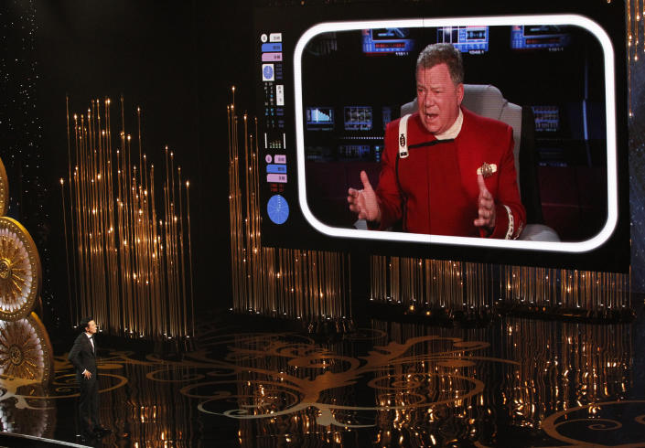 Oscar host Seth MacFarlane watches William Shatner on a screen during the opening segment of the 85th Academy Awards in Hollywood, California February 24, 2013.    REUTERS/Mario Anzuoni (UNITED STATES  - Tags: ENTERTAINMENT TPX IMAGES OF THE DAY)  (OSCARS-SHOW)