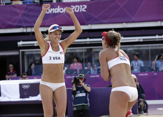 Jennifer Kessy, left, and April Ross of the United States celebrate their three set win over Spain during a beach volleyball match at the 2012 Summer Olympics, Thursday, Aug. 2, 2012, in London. (AP Photo/Dave Martin)