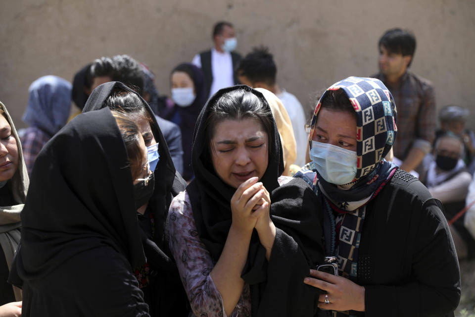Afghan Hazaras attend the funeral of Mina Khiari, who was killed in bombing last week, in Kabul, Afghanistan, Saturday, June 5, 2021. After the collapse of the Taliban 20 years ago, Afghanistan's ethnic Hazaras began to flourish and soon advanced in various fields, including education and sports, and moved up the ladder of success. They now fear those gains will be lost to chaos and war after the final withdrawal of American and NATO troops from Afghanistan this summer. (AP Photo/Rahmat Gul)