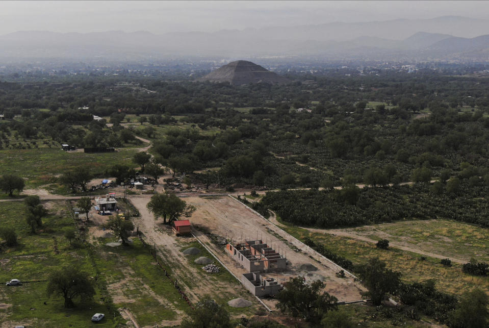 Construction of a private building project is seen on the outskirts of Teotihuacan, just north of Mexico City, Wednesday, May 26, 2021. The Mexican government said Tuesday that the project is destroying part of the outskirts of the pre-Hispanic ruin site and has repeatedly issued stop-work orders since March but the building crews have ignored them. (AP Photo/Fernando Llano)