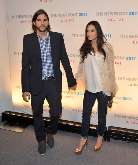 Ashton Kutcher and Demi Moore together in June.