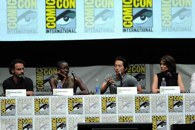 "Andrew Lincoln, Danai Gurira, Steven Yeun and Lauren Cohan speak onstage at AMC's ""The Walking Dead"" panel during Comic-Con International 2013 at San Diego Convention Center on July 19, 2013 in San Diego, California."
