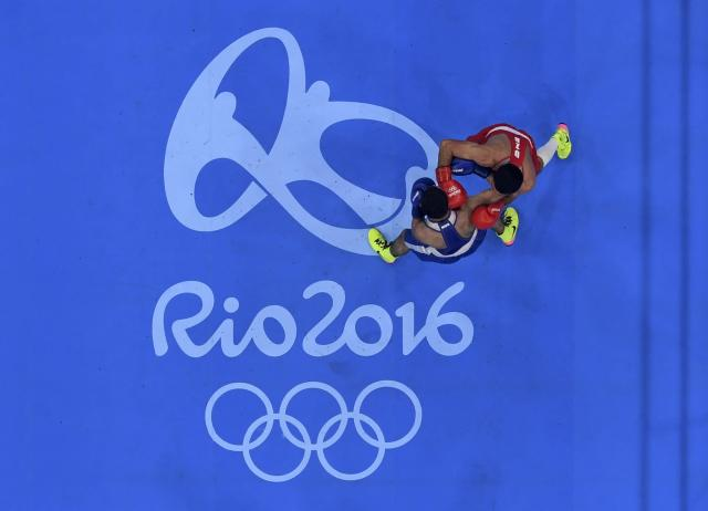 2016 Rio Olympics - Boxing - Final - Men's Fly (52kg) Final Bout 271 - Riocentro - Pavilion 6 - Rio de Janeiro, Brazil - 21/08/2016. Shakhobidin Zoirov (UZB) of Uzbekistan and Misha Aloian (RUS) of Russia compete. REUTERS/Pool FOR EDITORIAL USE ONLY. NOT FOR SALE FOR MARKETING OR ADVERTISING CAMPAIGNS.