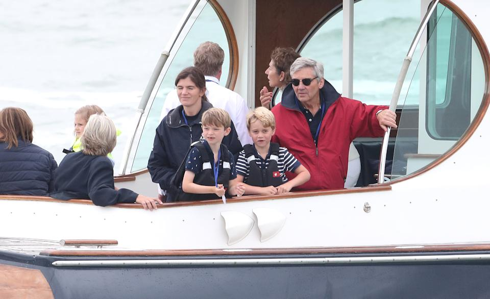 COWES, ENGLAND - AUGUST 08: Michael Middleton and Prince George watch the inaugural King's Cup regatta hosted by the Duke and Duchess of Cambridge on August 08, 2019 in Cowes, England. Their Royal Highnesses hope that The King's Cup will become an annual event bringing greater awareness to the wider benefits of sport, whilst also raising support and funds for Action on Addiction, Place2Be, the Anna Freud National Centre for Children and Families, The Royal Foundation, Child Bereavement UK, Centrepoint, London's Air Ambulance Charity and Tusk. (Photo by Chris Jackson/Getty Images)