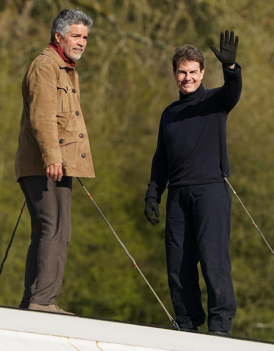 <p>Tom Cruise films with Esai Morales on top of a train for <em>Mission: Impossible 7</em> on Friday in North Yorkshire.</p>