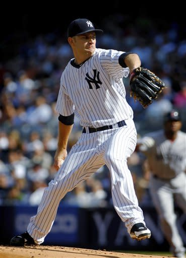 New York Yankees' David Phelps pitches to the Boston Red Sox during the first inning of a baseball game Saturday, Aug. 18, 2012, at Yankee Stadium in New York. (AP Photo/John Dunn)