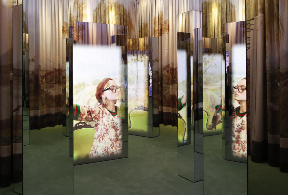 A view of a Gucci's advertisement campaign selected for an exhibition to celebrate creative vision of a creative director Alessandro Michele at Gucci Garden Archetypes, in Florence, Italy, Thursday, May 13, 2021. Alessandro Michele has radically shifted Gucci codes and challenged fashion norms in 6 ½ years as creative director at the brand founded by Guccio Gucci as a travel bag company in Florence 100 years ago. To mark the centenary, Michele has curated an exhibit in the brand's shop, restaurant and exhibition space, Gucci Garden, on Florence's Piazza della Signoria, that underlines some watershed moments: An advertising campaign for perfume featuring a transgender model, an all-Black cast for Pre-Fall 2017 campaign, and a lipstick campaign featuring everyday faces in all their imperfections. (AP Photo/Antonio Calanni)