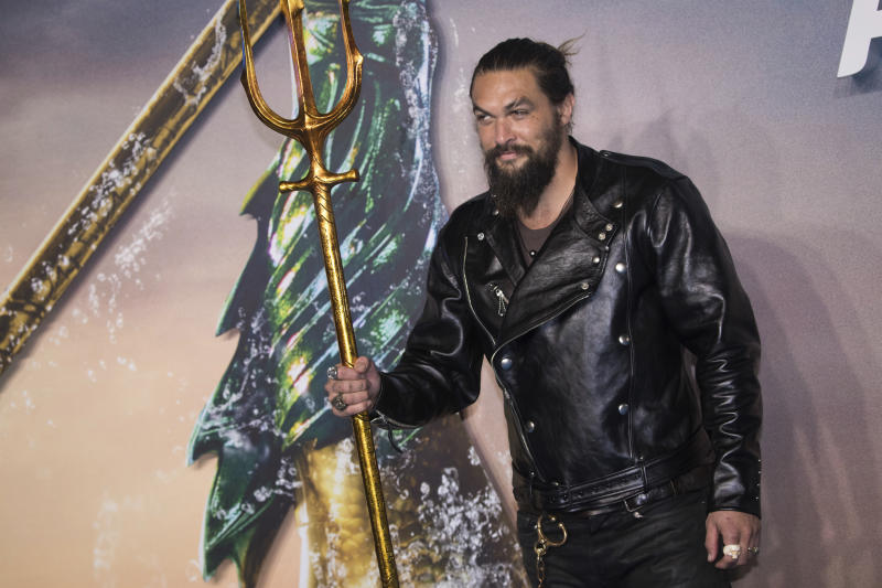 Jason Momoa poses for photographers upon arrival at the world premiere of the film 'Aquaman', in London, Monday, Nov. 26, 2018. (Photo by Vianney Le Caer/Invision/AP)