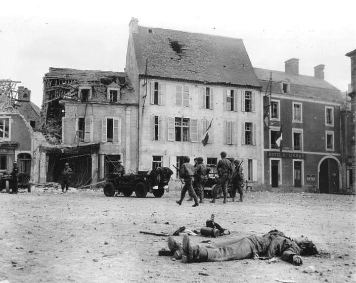 The body of a dead German soldier lies in the main square after the town was taken by U.S. troops who landed at nearby Omaha Beach in Trévières, France, on June 15, 1944. (Photo: U.S. National Archives/handout via Reuters)