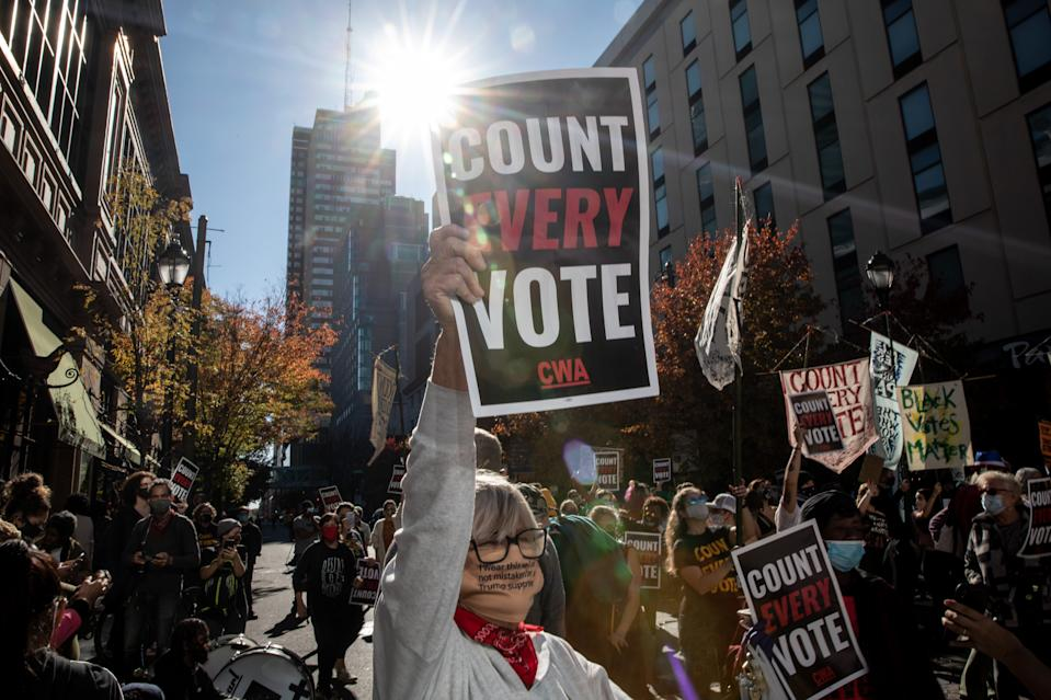 PHILADELPHIA, PENNSYLVANIA - NOVEMBER 05: A woman participates in a protest in support of counting all votes as the election in Pennsylvania is still remains too close to call on November 5, 2020 in Philadelphia, Pennsylvania. With no winner yet declared in the election, attention is focused on the outcome of a few remaining swing states.  (Photo by Chris McGrath/Getty Images)