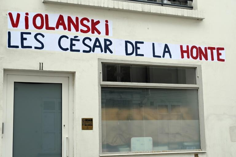 """Posters with a play on words combining the word rape in French with the name of Polish-French filmmaker Roman Polanski, and reading """"Violanski, the Cesars of shame"""" plastered on n the headquarters of the French film academy ahead of its 'Cesar' award"""