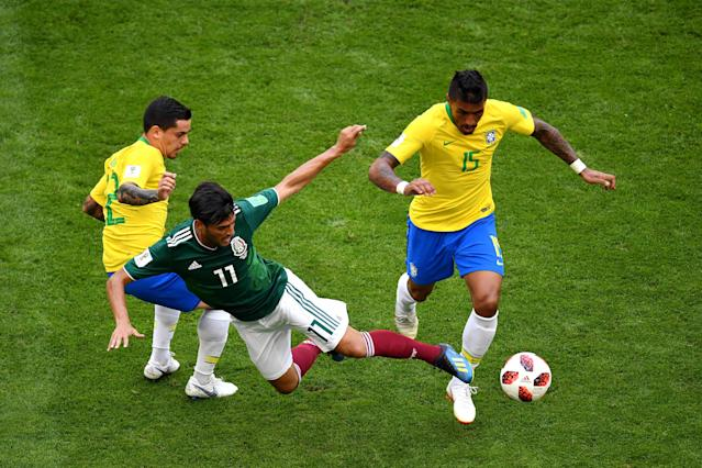 <p>Carlos Vela of Mexico tackles Paulinho of Brazil during the 2018 FIFA World Cup Russia Round of 16 match between Brazil and Mexico at Samara Arena on July 2, 2018 in Samara, Russia. (Photo by Hector Vivas/Getty Images) </p>