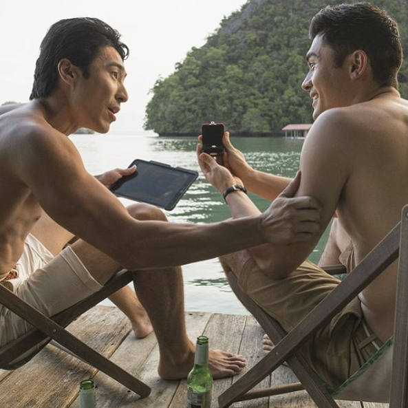 Chris (L) starred in box office success Crazy Rich Asians, pictured here in the film alongside co-star Henry Golding (R). Photo: Roadshow Films