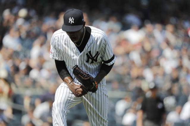New York Yankees starting pitcher Domingo German reacts after three straight strikeouts against the Boston Red Sox in the sixth inning of a baseball game, Saturday, Aug. 3, 2019, in New York. (AP Photo/Michael Owens)