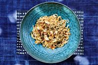 """A slight twist on scallion noodles, this lip-smacking salad gains texture from a crunchy, spicy garlic topping. <a href=""""https://www.epicurious.com/recipes/food/views/ramen-noodles-with-spring-onions-and-garlic-crisp?mbid=synd_yahoo_rss"""" rel=""""nofollow noopener"""" target=""""_blank"""" data-ylk=""""slk:See recipe."""" class=""""link rapid-noclick-resp"""">See recipe.</a>"""