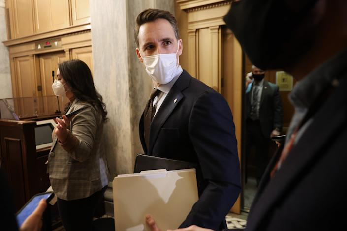 Senator Josh Hawley has been watching most of the Trump impeachment trial from the gallery above the chamber, going through paperwork, according to reports. (Getty Images)