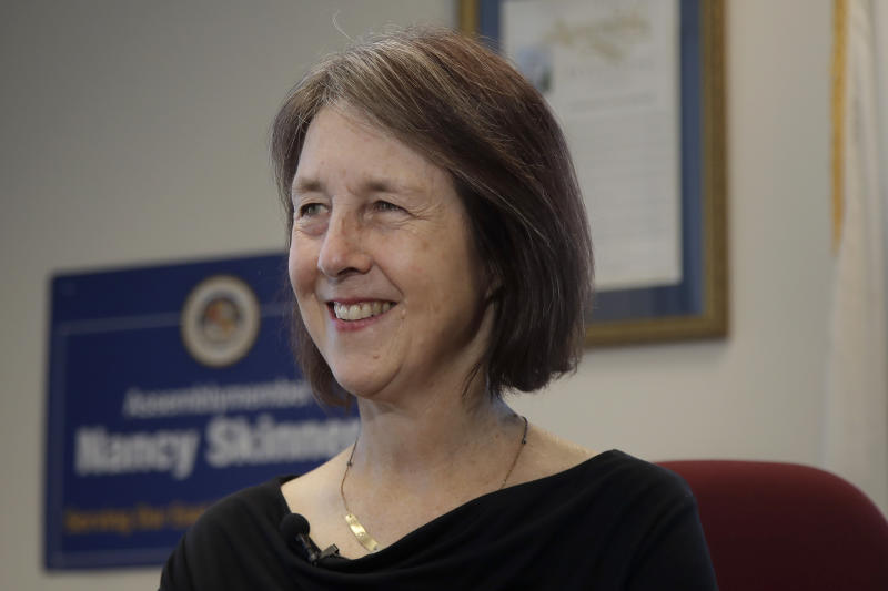 Democratic state Sen. Nancy Skinner, author of the bill that allows athletes at California colleges to hire agents and sign endorsement deals, smiles while being interviewed at her office in Oakland, Calif., Monday, Sept. 30, 2019. Defying the NCAA, California opened the way Monday for college athletes to hire agents and make money from endorsement deals with sneaker companies, soft drink makers and other sponsors, just like the pros. (AP Photo/Jeff Chiu)