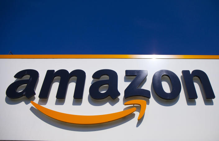 FILE - In this April 16, 2020, file photo, the Amazon logo is displayed in Douai, northern France. Some 130 countries have backed a global minimum tax as part of a worldwide effort to keep multinational firms from dodging taxes by shifting their profits to countries with low rates. The agreement announced by the Organization for Economic Cooperation and Development Thursday also provides for taxing the largest global companies in countries where they earn profits through online businesses but may have no physical presence.(AP Photo/Michel Spingler, File)