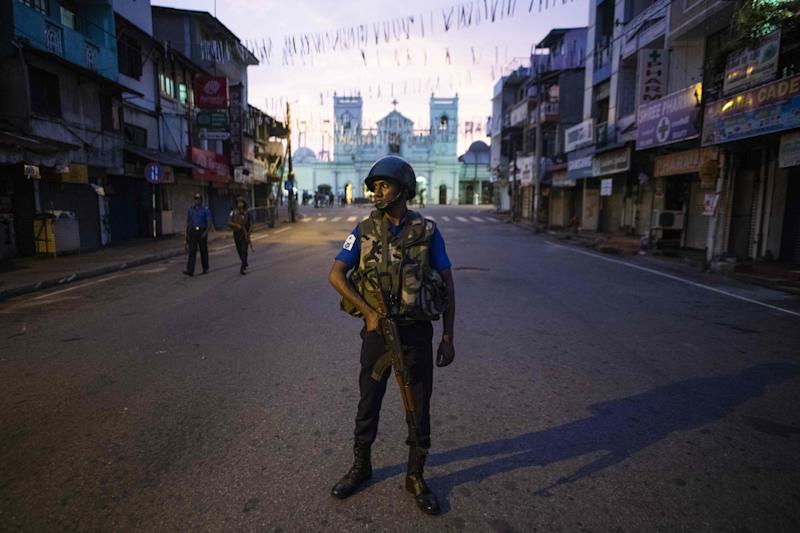 A soldier stands guard St. Anthony's Shrine in Colombo on April 26, 2019, following a series of bomb blasts targeting churches and luxury hotels on Easter Sunday in Sri Lanka. - Authorities in Sri Lanka on April 25 lowered the death toll in a spate of Easter bombings by more than 100 to 253, admitting some of the badly mutilated bodies had been erroneously double-counted. (Photo by Jewel SAMAD / AFP) (Photo credit should read JEWEL SAMAD/AFP/Getty Images)