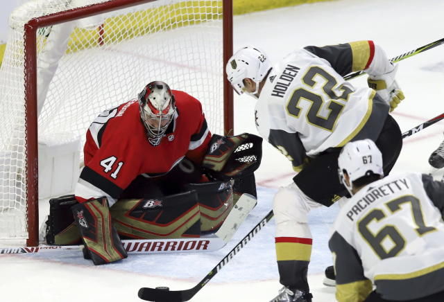 Vegas Golden Knights defenseman Nick Holden (22) scores on Ottawa Senators goaltender Craig Anderson (41) as Vegas Golden Knights left wing Max Pacioretty (67) looks on during the second period of an NHL hockey game, Wednesday, Nov. 8, 2018 in Ottawa, Ontario. (Fred Chartrand/The Canadian Press via AP)