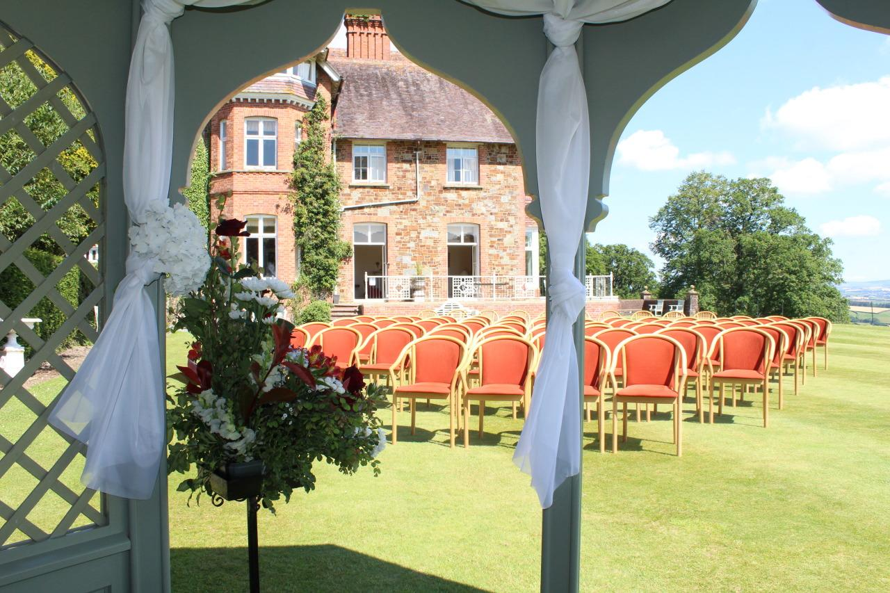 "<p>You don't need to go all the way to Italy to feel like you're getting married in a Tuscan villa. Overlooking the rolling hills of Devon, <a href=""http://www.highbullen.co.uk/"">Highbullen Hotel</a>, Golf and Country Club has a Palazzo with architectural nods to the Tuscan style, with barrelled ceilings, feature domes, statues and murals. Get married in the pagoda on the croquet lawn, then head inside to rooms named after Roman leaders, from Marcus Aurelius to Caesar. [Photo: Highbullen Hotel]</p>"